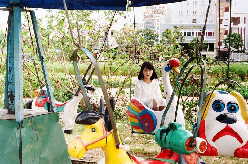 Young woman in retro amusement park