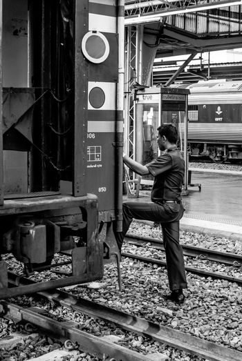 Train station staff at railway Bangkok Black & White Black And White Carry City Life Grip Life Man Offical People Railway Railway Station Rest Street Photography The Portraitist - 2016 EyeEm Awards Track Train Train Station Train Tracks Transportation Vintage Working The Street Photographer - 2016 EyeEm Awards My Commute My Commute-2016 EyeEm Photography Awards