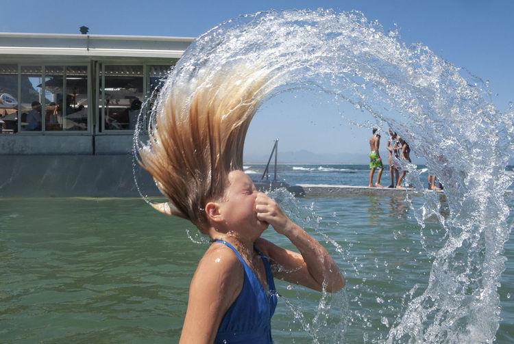 Young girl having fun in a swimming pool at summertime. Fun Hair Holiday Girls Pool, Summer Swim Swimming Pool