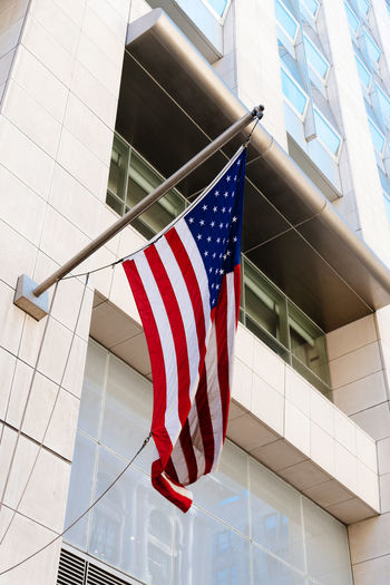 American flag against building American Flag Manhattan New York New York City Travel USA America Architecture Building Building Exterior Built Structure Day Directly Below Flag Independence Low Angle View Nature No People Outdoors Patriotism Pride Red Shape Star Shape Striped Symbol Tiled Floor White Color