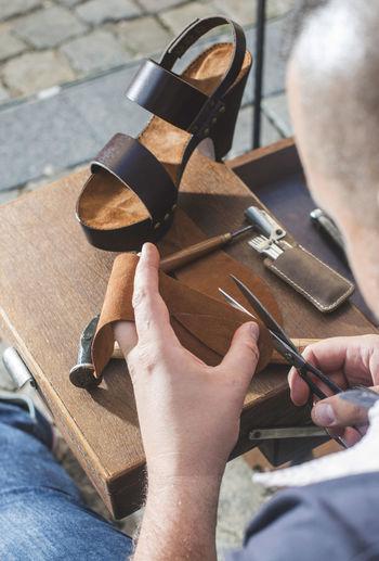 Close-up of shoemaker making sandal at workshop