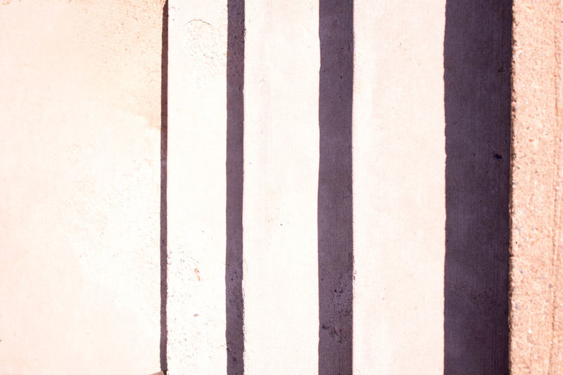 We are aligned Backgrounds Day Full Frame In A Row LINE No People Outdoors Parallel Pattern Shadow Striped Sunlight Textured  Wall Wall - Building Feature