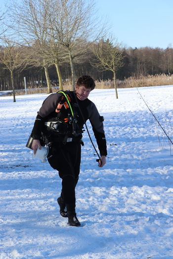 Full length of man on snow covered field