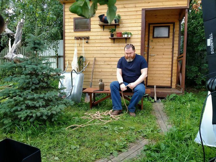 Man sitting on seat in yard