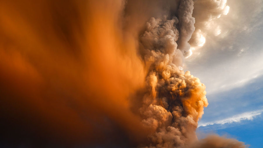 Close-up of fire against sky