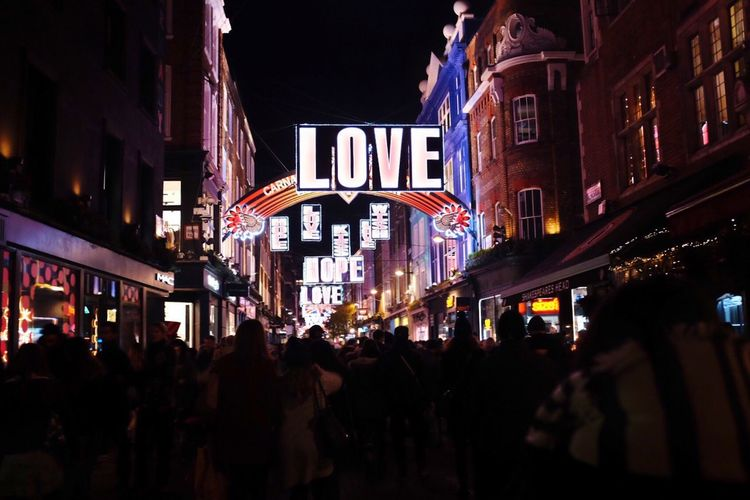 Illuminated Night Building Exterior Text Neon Architecture Crowd People Shopping Christmas City Life Street Photo Streetphotography Street Photography Candid Photography Streetphoto Tourist Attraction  City Red Carnaby Street Christmas Lights Christmas In London