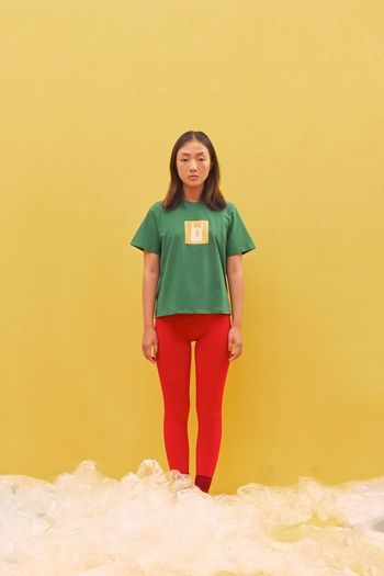 Fashion Standing Full Length One Person Front View Portrait Yellow Looking At Camera