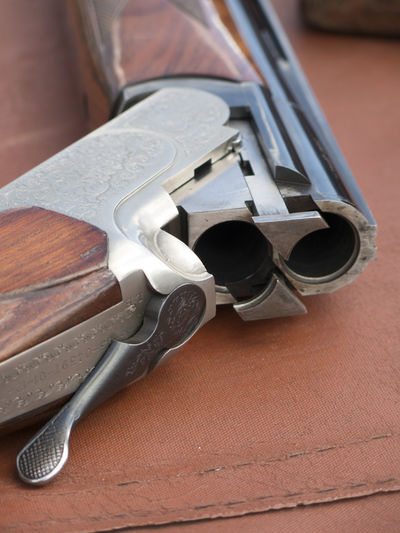 Close-Up Of Gun On Table