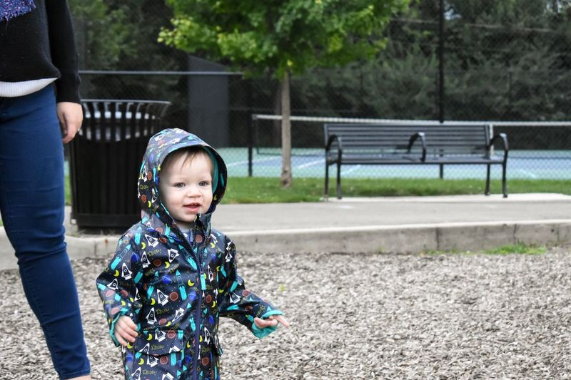 Boy with mother at park