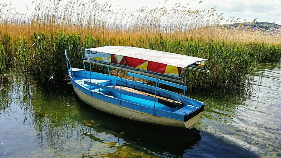Boat on lake Moored Boat Tourist Destination Travel Destinations Macedonia Boat Boat On Water Boat On Lake Lake Reeds At The Lake Reeds By Water Reeds In Water Reedslake Outdoors Ohrid Lake Ohrid Macedonia Water Nautical Vessel Transportation Day Nature High Angle View Sky