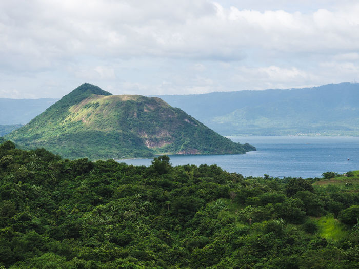 Taal Lake Taal Volcano Beauty In Nature Day Green Color Landscape Mountain Nature No People Outdoors Scenics Sea Sky Taal Tranquil Scene Water