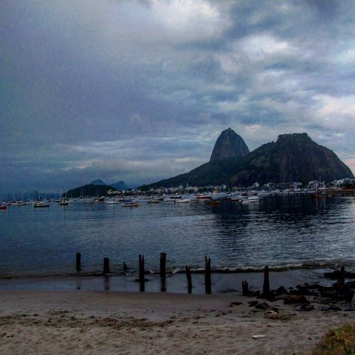 Enseada de Botafogo Water Sky Cloud - Sky Beach Land Sea Mountain Scenics - Nature Nature Beauty In Nature No People Tranquility Architecture Travel Destinations Tranquil Scene Day Outdoors Non-urban Scene Sand