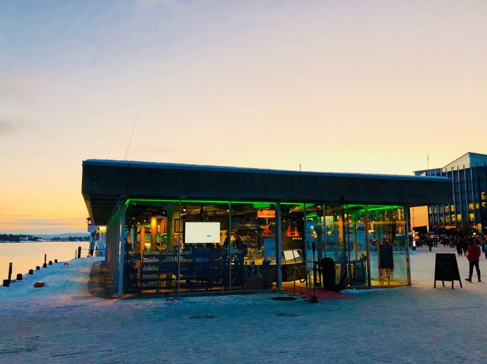 Fish restaurant at Rådhusbrygga in Oslo #iphoneonly #Iphoneography #iphonex #photography #norway #oslofjord #Oslo Built Structure Clear Sky Outdoors Beach Sunset Architecture Sky Sea