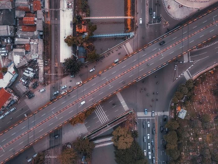 Aerial view of cars moving on bridge in city