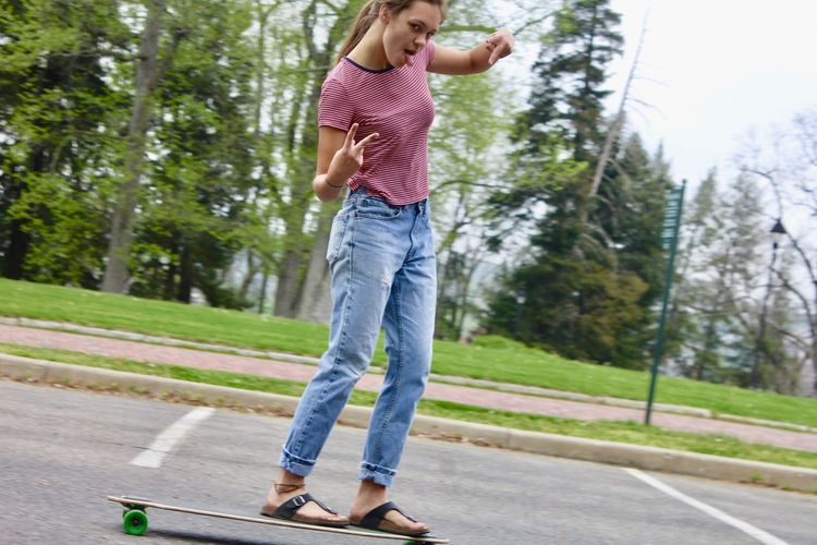 Teenage Girl On Longboard