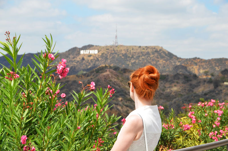 Beauty In Nature Blooming Casual Clothing Fashion Fashion Photography Fashionblogger Flower Focus On Foreground Freshness Hairstyle Hill Hollywood Hollywood Sign Lady Mountain Outdoors Pink Color Plant Red Hair Redhead Sky Woman