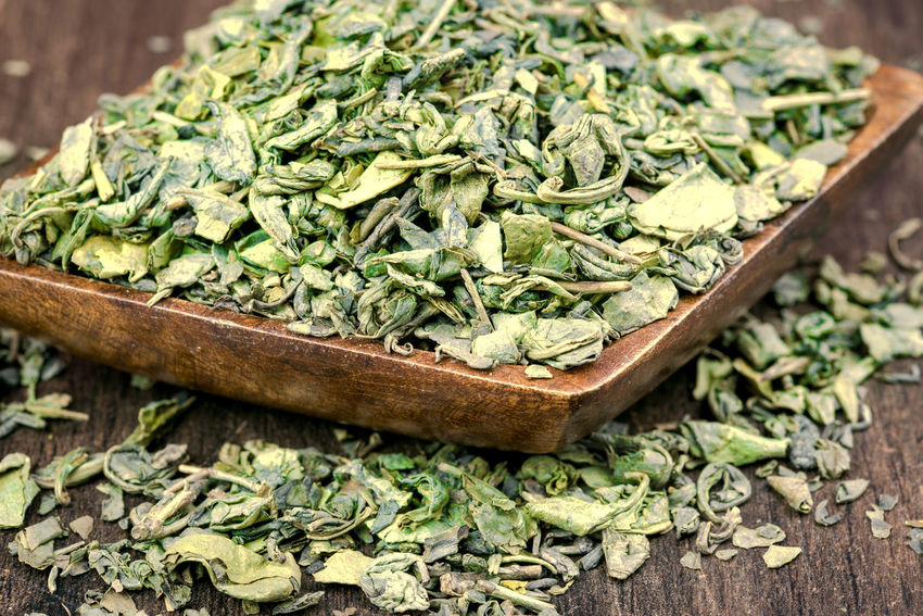 Green or black tea leaves on wooden plate or background Aroma; Aromatic; Asia; Asian; Basket; Beverage; Chinese; Culture; Drink; Dry; Drying; Fragrance; Green; Green Tea; Harvest; Leaf; Leaves; Macro; Organic; Plant; Process; Roast; Tea; Traditional; Wood; First Eyeem Photo