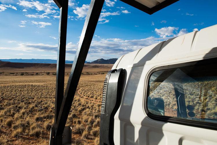 Close-Up Of Off Road Vehicle On Arid Landscape