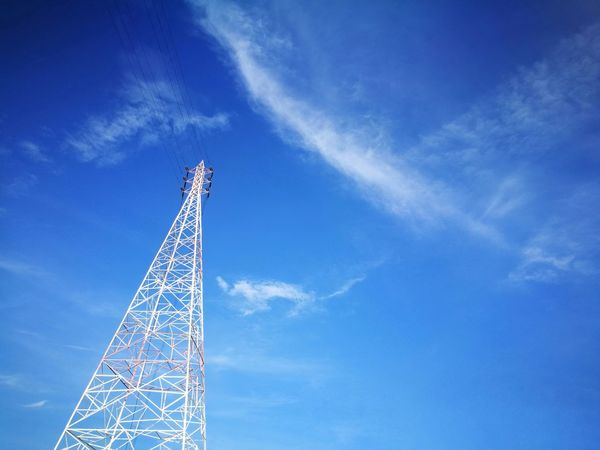 electric tower on blue sky Tower Global Communications Technology Blue Sky No People Wire Danger Safe Cable Wires Outdoors Electronic Tower Steel Matel