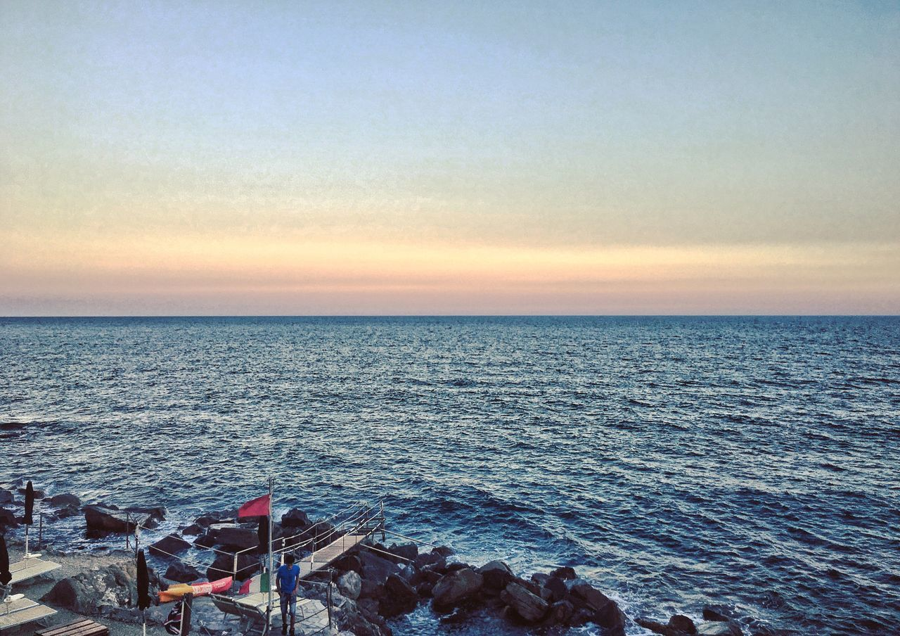 sea, horizon over water, sunset, scenics, nature, water, no people, beauty in nature, tranquility, sky, outdoors, tranquil scene, beach, clear sky, day