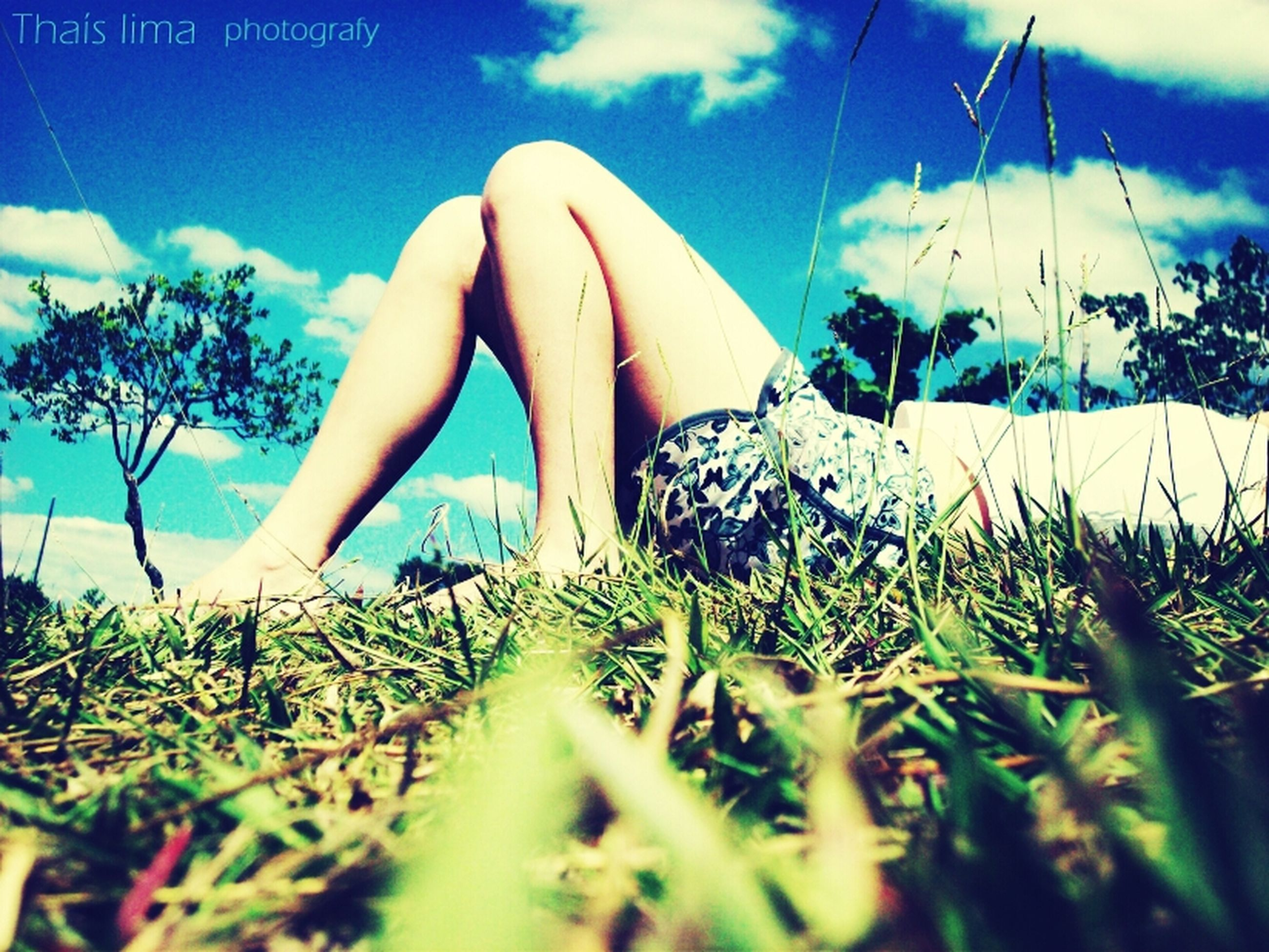 sky, plant, low section, person, grass, growth, tree, blue, part of, day, sunlight, field, cloud, nature, cloud - sky, outdoors