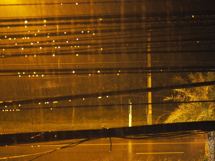 Light from the street in rain day Street Vintage Rain Bokeo Feel Lonely On The Street Shadow Thailan Pattern Black Brown Light Illuminated Backgrounds Sky Focus On Shadow Rainfall Rainy Season Drop Yellow Line Blooming Vehicle White Line Street Scene Aircraft Wing Cobbled Airport Runway Growing High Street Full Frame