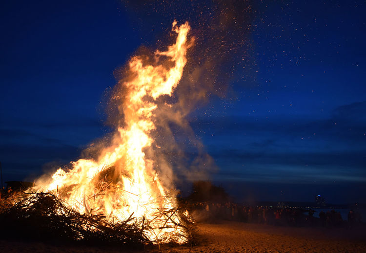 Bonfire At Beach During Night