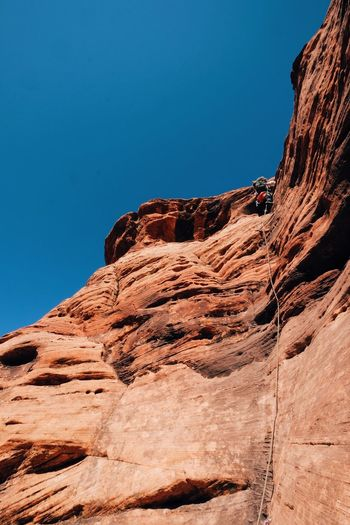 Rope Utah Zion National Park Beauty In Nature Blue Clear Sky Cliff Climbing Day Low Angle View Mountain Nature No People Outdoors Rock - Object Scenics Sky