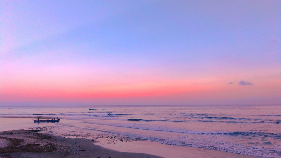 by the bay EyeEmNewHere Water Wave Sea Low Tide Sunset Beach Sand Multi Colored Summer Horizon Dramatic Sky Coastal Feature