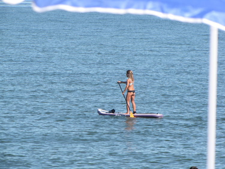 Photo I shot with my Canon PowerShot SX10is of a paddle boarder on the beach