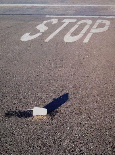 Litter in the parking lot Litter tossed Debris street Stop stop sign trash Urban Debris