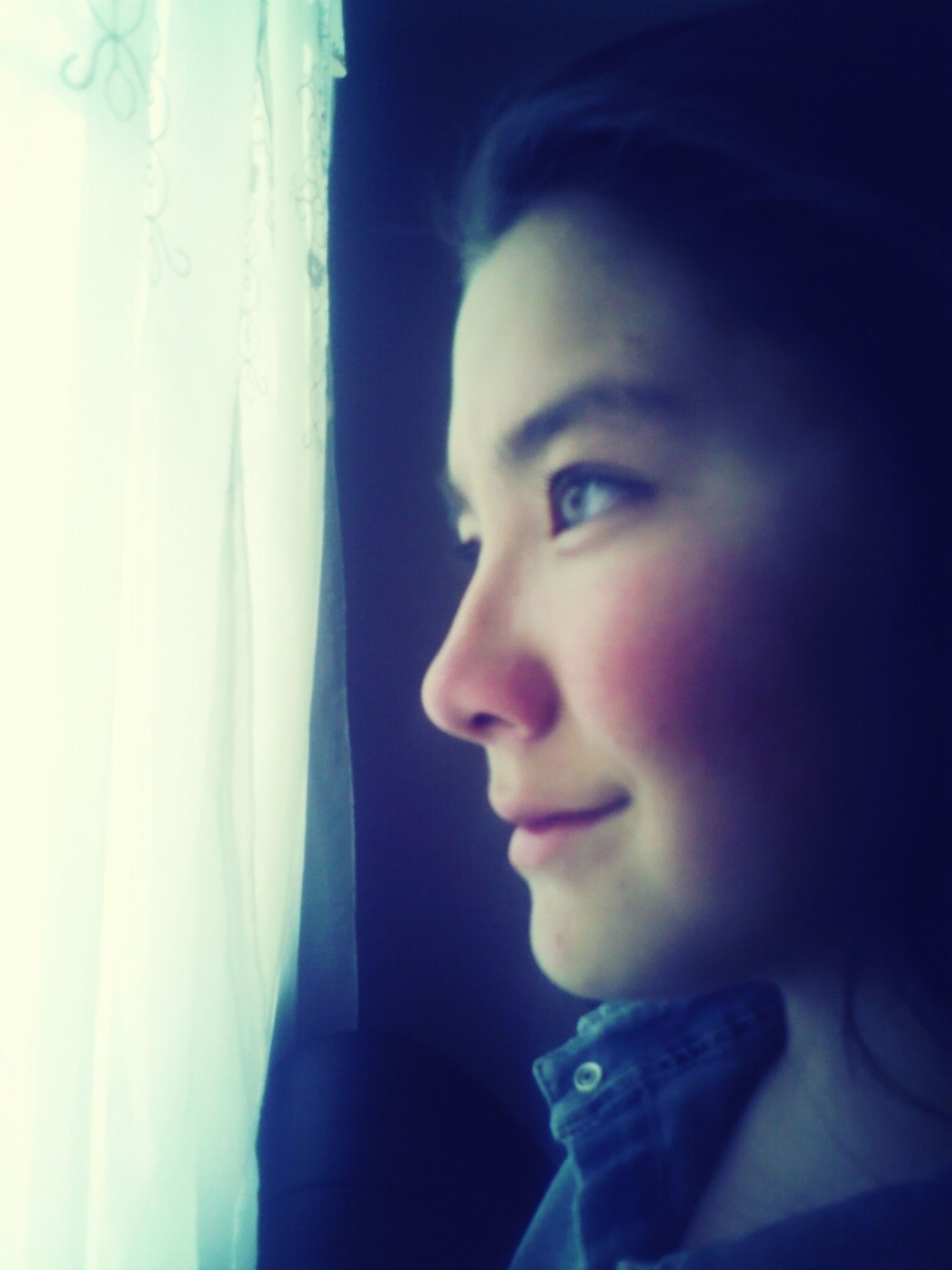 headshot, person, lifestyles, young adult, indoors, leisure activity, contemplation, portrait, head and shoulders, looking at camera, young women, front view, close-up, human face, window, copy space, serious
