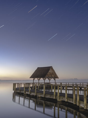 Startrails over pierhouse. Architecture Beauty In Nature Blue Built Structure Horizon Horizon Over Water Lakeside Nature Night No People Outdoors Pier Scenics - Nature Sea Sky Startrail  Tranquil Scene Tranquility Water Waterfront
