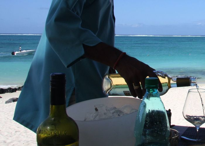 Bar Beach Better Look Twice Drink Enjoying Life Food And Drink Getting Away From It All Horizon Over Water Leisure Activity Lifestyles Lunch Time! Mauritius Men Ocean Part Of Retaurant Service Sky Taking Photos Travel Vacation White Wine Wine Wineandmore Winetasting