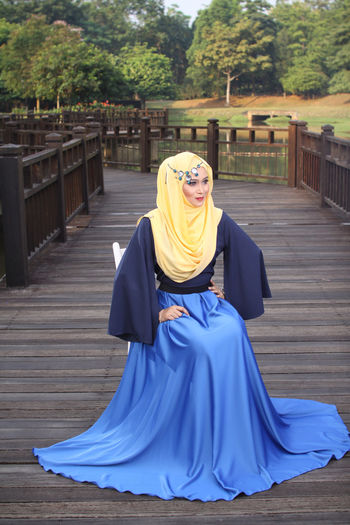 Beautiful Woman In Hijab Sitting On Boardwalk