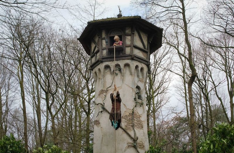 Attraction theme park the Efteling, Kaatsheuvel, the Netherlands. Tree Bare Tree Built Structure Plant Architecture Religion Nature Building Exterior Low Angle View Belief Spirituality Representation No People Day Human Representation Art And Craft Statue Male Likeness Sculpture Outdoors