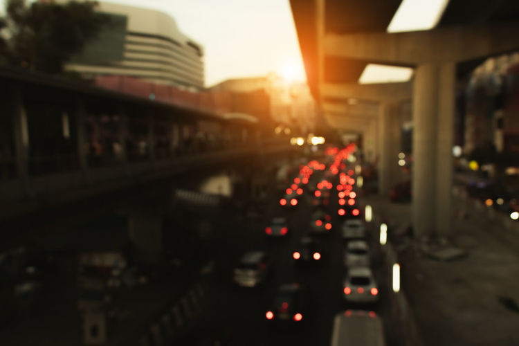 View of traffic on road at sunset