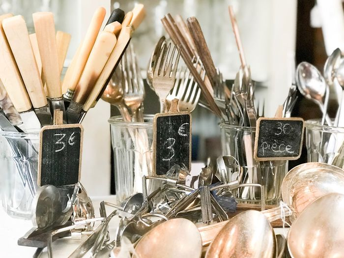 Kitchen utensils in containers in store