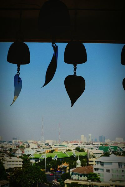 Hanging Religion Cultures Cityscape Outdoors Roof Architecture Urban Skyline Building Exterior Spirituality Travel Travel Destinations Buddha Temple, Thailand Buddha Temple Outdoor Photography Architecture Bangkok Thailand. History Pagoda Ancient