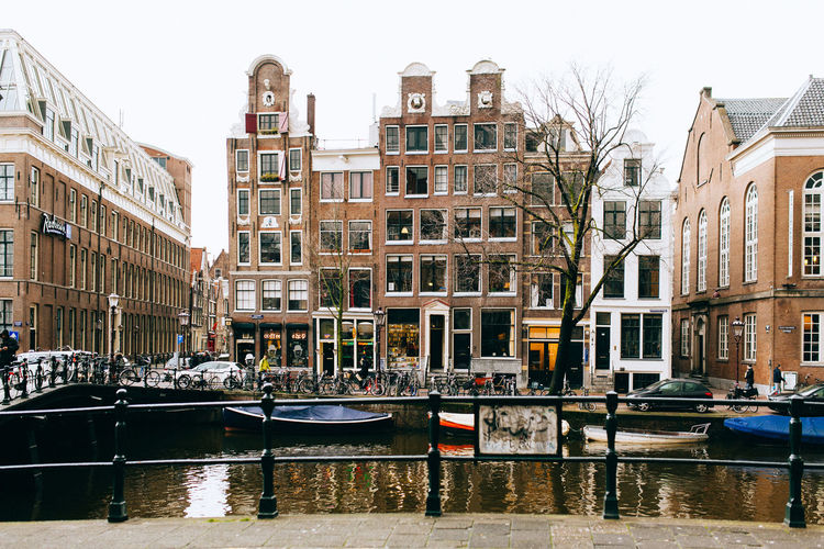 A Wintery Amsterdam ... All Streets Amsterdam Architecture Boat Building Building Exterior Built Structure Canal Car City Clear Sky Day Incidental People Mode Of Transport Moored Nautical Vessel Residential Building Residential Structure Sky Transportation Water Waterfront Your Amsterdam