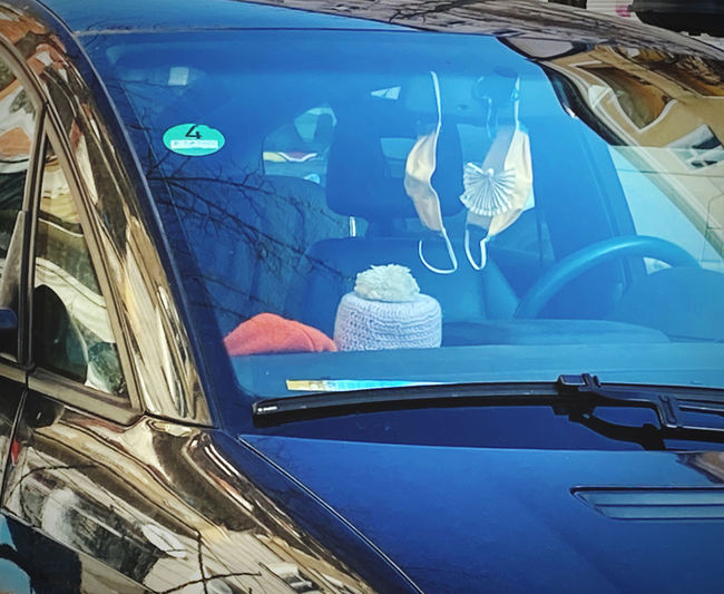 Reflection of car on glass window