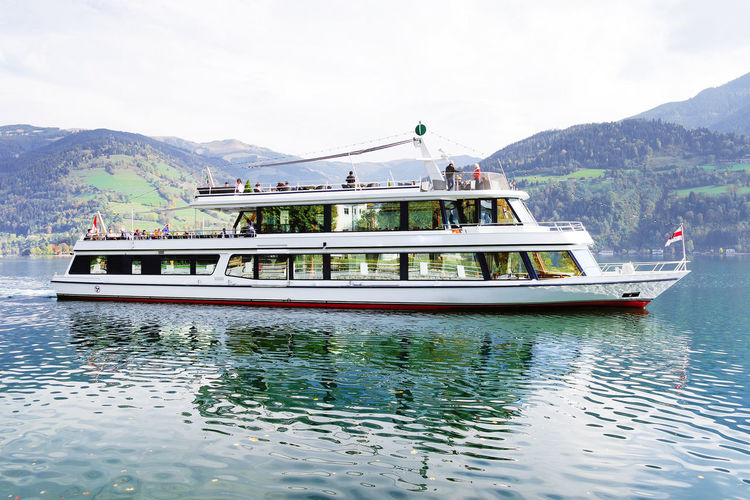 Zell am See resort in Austria, Europe Water Mountain Nautical Vessel Transportation Mode Of Transportation Waterfront Nature Day Passenger Craft Outdoors Lake Lake View Lakeshore Lakeside Travel Travel Destinations Travel Photography Landmark Ship Touristic Shoes Transportation Zell Am See Resort Landscape_Collection Resortlife