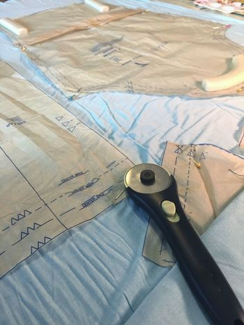 Prepearing to sew: Pinning a pattern before using a rotary cutter. High Angle View Indoors  Table Equipment Paper No People Close-up Day Sewing Pattern Sewing Pattern Pins Rotary Cutter Sew Tailor Blue Preparation  The Week On EyeEm