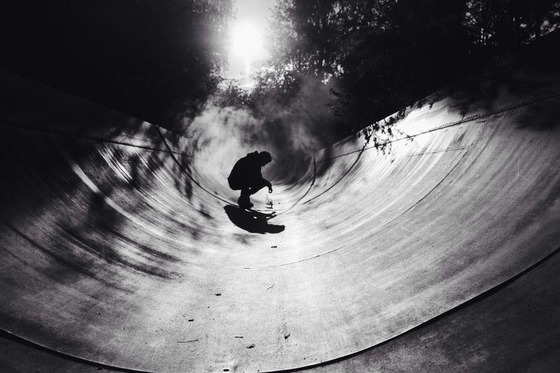 Man crouching on skateboard