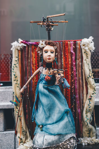 Violinist woman puppet, blue dressed, in Ávila Medieval Journey Avila AvilaMedieval Doll MedievalTown Puppet Show Puppets Blue Dress Coathanger Fashion Hanging Looking At Camera Medieval Medieval Festival Puppet Puppets With A String Violinist Violinist Puppet