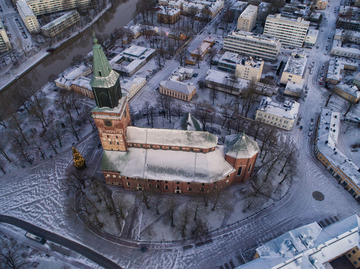 Aerial view of illuminated historic church during sunset