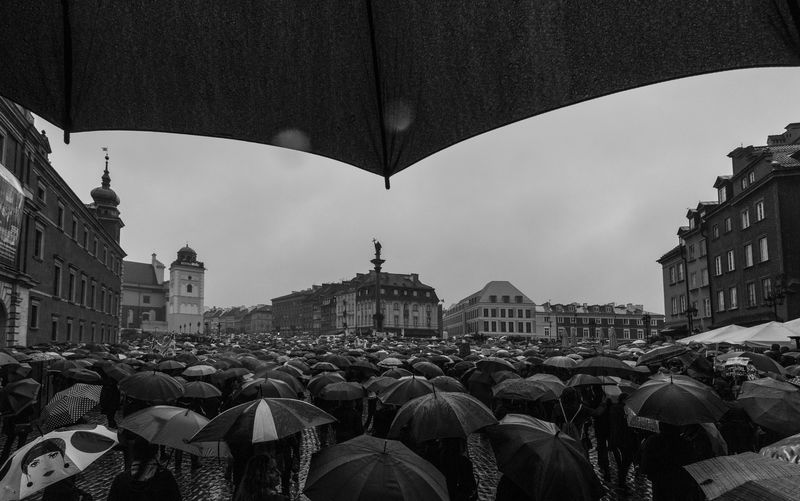 Crowd With Umbrellas In City During Rain