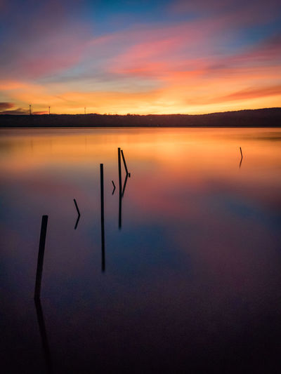 magic play of colors over the lake Beauty In Nature Colorful Sky Lake Nature No People Outdoors Reflection Scenics Shadow Silhouette Sky Sunrise Tranquil Scene Tranquility Water