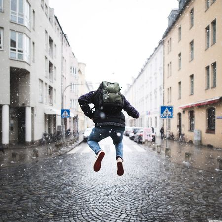 Jippie it's snowing 😊 Munich Happy Winter Snow Jump Building Exterior Architecture One Man Only Full Length Built Structure Shades Of Winter City Mid-air Men Motion Warm Clothing Rear View Stories From The City
