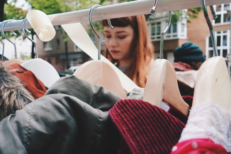Close-up of young woman shopping outdoors